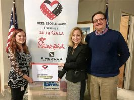 Abby Bradley (left), representing Reel People Care, celebrates the success of the organization's winter gala with Nancy Meaders, director of Fayette Senior Services, and Dan Gibbs, FSS Director of Operations. Photo/Submitted.