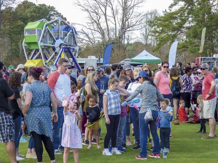 Hundreds of party-goers enjoyed a day of food, rides and balloon-twisting at Drake Field in Peachtree City in observance of the founding of Peachtree City 60 years ago. Photo/Ben Nelms.