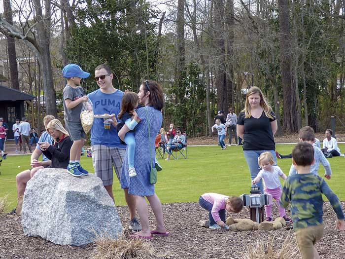Parents and children play and talk at Drake Field near City Hall Plaza in Peachtree City. Photo/Ben Nelms.