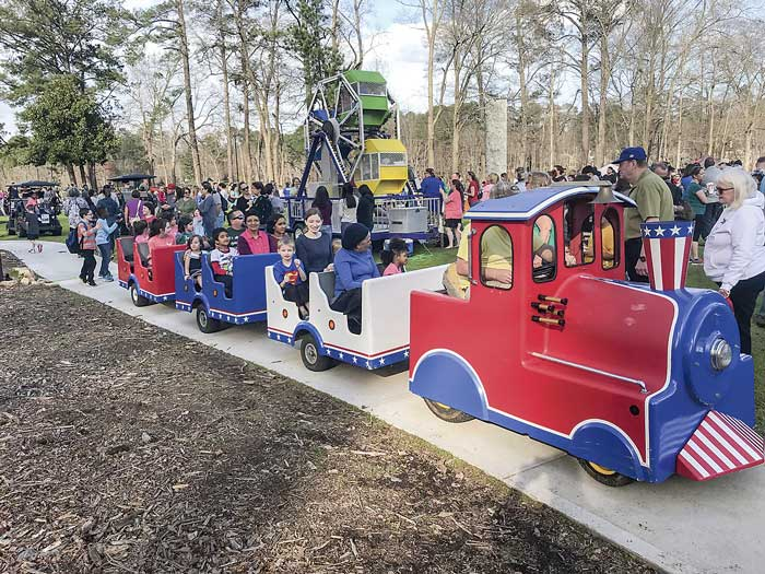 One of the many entertainments at the 60th birthday celebration was a pint-sized passenger train. In the background is a miniature Ferris wheel that stayed busy going in circles all Saturday afternoon, as well as other scenes of festive enjoyment. Photos/Ben Nelms.