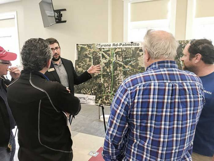 Residents hear an explanation of possible changes to a major corridor in the northwest part of Fayette during a March 18 public meeting to gain input on transportation improvements for the Sandy Creek Road, Tyrone Road-Palmetto Road, Banks Road and Ga. Highway 279 corridors. Photo/Ben Nelms.
