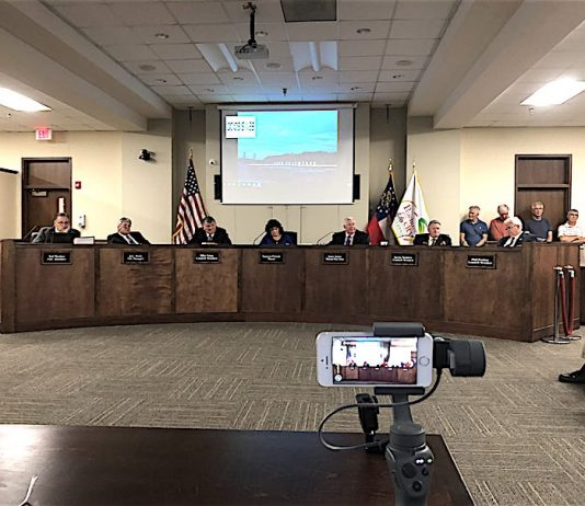 The Peachtree City Council April 18 with the public comment timer running on the screen behind them. Photo/Cal Beverly.