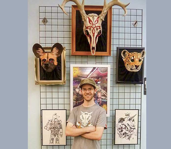 Eric Strother, one of three artists exhibiting in the POW!POP! exhibit in the Peachtree City Library Art Initiative, stands in front of a few of his fantastic masks. The exhibit continues through June with a reception Sunday, June 2, from 3 TO 4:45 p.m. at the Peachtree City Library, Willow Bend Road, Peachtree City.