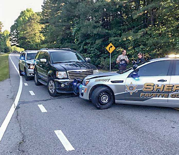 Chase ends when suspects crash into Fayette deputy's car - The Citizen