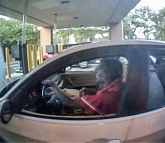 Surveillance photo of south Peachtree City carjacker. Photo/Peachtree City Police.