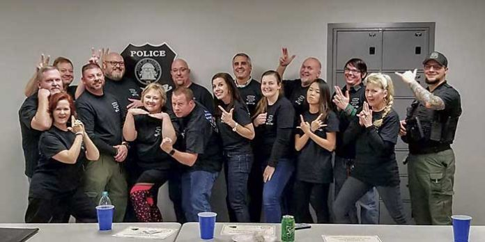 Members of the inaugural Tyrone Citizens Police Academy from 2018 are: back row from left, Robert Junior, Lt. Philip Nelson, Paul Brooks, Steven Kagey, Scot Vanderbeck, James, Casey and Cpl. Eric Minix; and back row from left, Major Van Brock, Dee Baker, Lt. Eric DeLoose, Michelle Banks, Todd Hamill, Colleen Adams, Morgann-Elizabeth Markoe, Kristina Honea and Carolyn Flegel. Photo/Submitted.