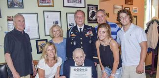 Above: Frank Forth with family and US Army Col. (ret) Rick White. Photo / Tony Armstrong.