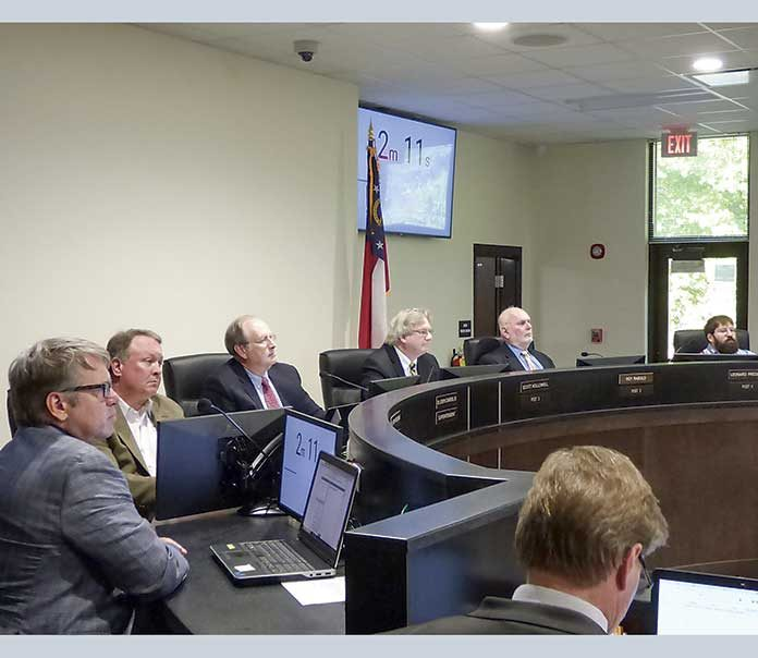 Present at May 20 meeting of the Fayette County Board of Education were, from left, board members Brian Anderson and Barry Marchman, Superintendent Jody Barrow, Chairman Scott Hollowell and board members Roy Rabold and Leonard Presberg. Photo/Ben Nelms.