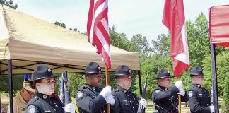 The Fayette County Sheriff's Office Color Guard presented the colors at the Memorial Day ceremony held at Patriot Park in Fayetteville. Photo/Ben Nelms.