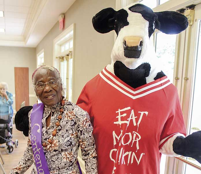 Eliza Spicer celebrates her 100th birthday with the help of a famous cow. Photo/Submitted.