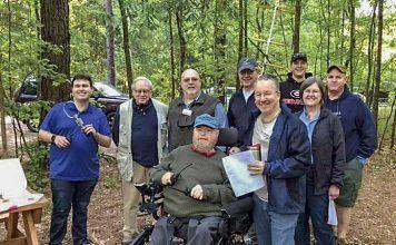 Pictured are (L-R) Ryan Bibby (KN4RQL), John Snellen (AI4RT), Brian Haren (W8BYH), Bob Gibler (NF5F), Jason Kirkbride, Tom Kirkbride (K1EOD); front, from left: Huey Kenmar (KI4NGD), Jeff Anderson (KK4BCH), Karen Gibler (KA5TFQ). Photo/Joe Domaleski (KI4ASK).