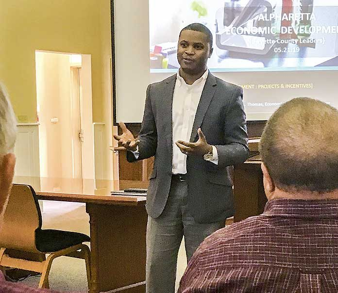 Alpharetta Development Manager Matthew Thomas recently gave Fayette County Development Authority members and local elected officials a look at what his city accomplished in bringing about the expansive Avalon mixed-use development. Photo/Ben Nelms.