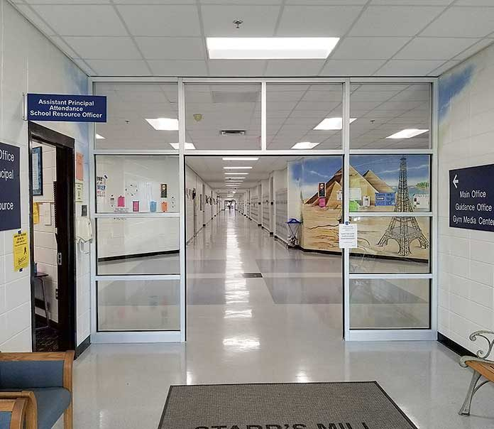 "Starr's Mill High School has a new entrance vestibule for more security. This vestibule is part of the new heightened secuity measures taken by the Fayette County School System. Another new item is the visitor management system, which will require a sign-in and a ""quick background check"" at all schools. Photo/Fayette County School System."
