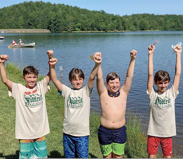 These members of Boy Scout Troop 75 earned Mile Swim Awards this summer. Pictured, from left, are Luke Hofrichter, Max Nolen, Jake Harper, and Jack Lynch. Photo/Submitted.