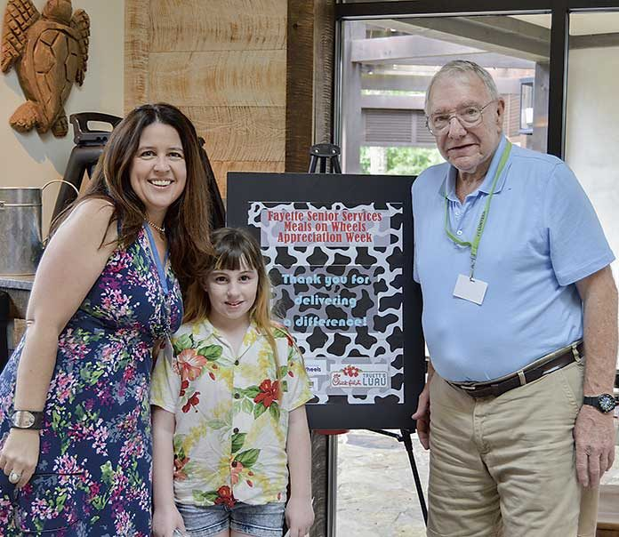 Pictured are Natalie Hynson, FSS Case Manager, Oscar Keplinger, MOW Volunteer, and Oscar's granddaughter who ran the route with him during her time off from school this summer.