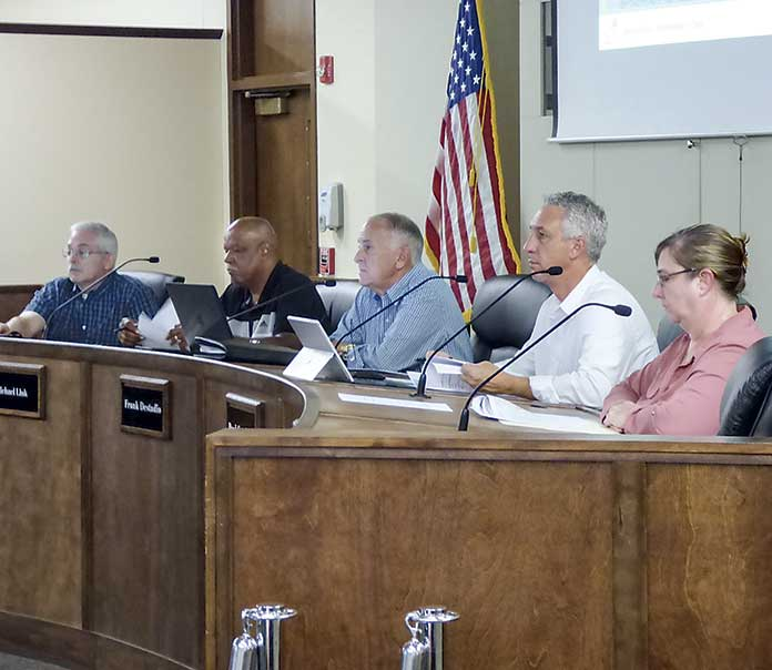 The Peachtree City Planning Commission on July 8 listen to a preseentation. Pictured, from left, are commissioners J.T. Rabun and Michael Link, Chairman Frank Destadio and commissioners Paul Gresham and Lisa Ann Curtis. Photo/Ben Nelms.