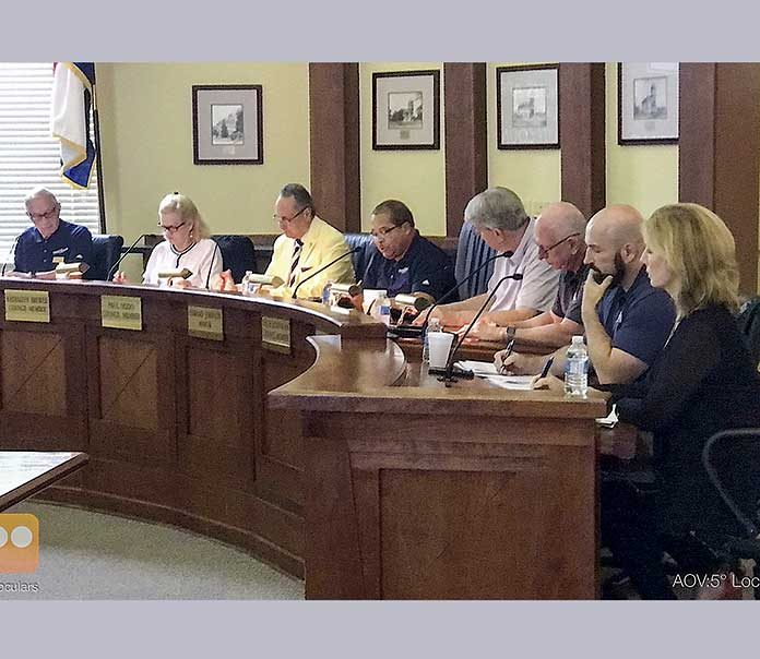 Pictured at the July 18 meeting, from left, are council members Harlan Shirley, Kathaleen Brewer and Paul Oddo, Mayor Ed Johnson, council members Rich Hoffman and Scott Stacy, City Manager Ray Gibson and City Clerk Anne Barksdale. Photo/Ben Nelms.