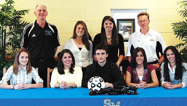 Kelley O'Hara signs her letter of intent to attend Stanford University, from The Citizen, February 2006 — Starr's Mill High School had seven soccer players sign letters of intent on Wednesday afternoon. The Lady Panthers had six players sign scholarships. Adrienne Phillips and Jamie Daley both signed with West Georgia, while Tannah Castro signed with Furman University, Sarah Capati signed with Berry, Katie Jacobsen signed with the University of Georgia and Kelley O'Hara signed with Stanford University. On the boys side, Riley Phelps signed with Coastal Carolina University. In the front row, from left, are Adrienne Phillips, Tannah Castro, Riley Phelps, Jamie Daley and Sarah Capati. In the back row are Starr's Mill Lady Panthers head coach Greg Shifflett, Kelley O'Hara, Katie Jacobsen and 88 PTC Lazers Coach Brian Moore. Photo/Special.