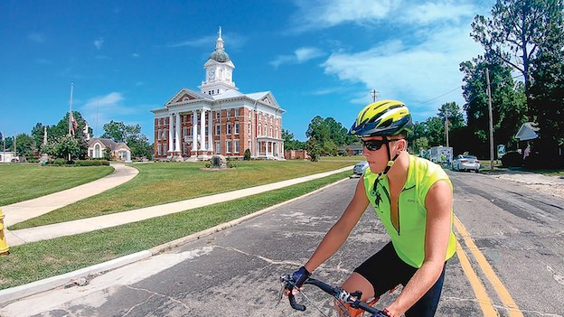 Fayette County resident Camden, 16, cycles through Millen, Ga., on route to completing a 500-mile annual bike ride with the Paul Anderson Youth Home. Photo/Submitted.