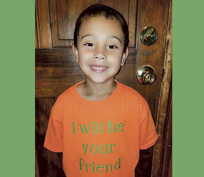 Blake Rajahn models his T-shirt offer on his mom's Facebook page.