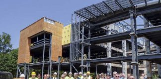 "South-Tree Enterprises construction workers, building owners and architects on Aug. 1 attended the ""topping off"" of the new SMC3 office building on Lexington Circle in Peachtree City. Photo/Ben Nelms."