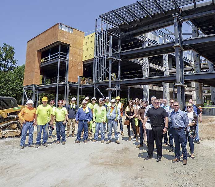 """South-Tree Enterprises construction workers, building owners and architects on Aug. 1 attended the """"topping off"""" of the new SMC3 office building on Lexington Circle in Peachtree City. Photo/Ben Nelms."""