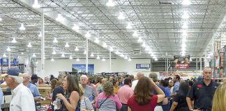 The new Costco at the Fischer Crossing commercial area along Ga. Highway 34 in east Coweta County opened Aug 22. It was on the previous evening that a few thousand took advantage of a wealth of complimentary meals while getting a close-up look at the offerings in store for customers the following day. Photo/Ben Nelms.