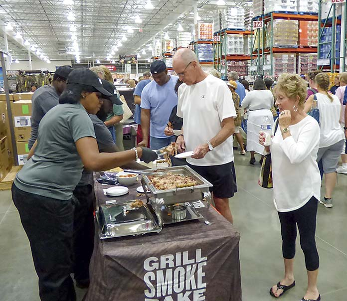 <b>Customers line up for grand opening taste treats at Costco. Photo/Ben Nelms.</b>