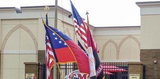 The Georgia Military College Color Guard posts the colors and the Marine Corps League, Maj. Stephen W. Pless Detachment 1196, at rear, raises Old Glory at the Aug. 20 grand opening of GMC's Phase 2 expansion in Fayetteville. Photo/Ben Nelms.