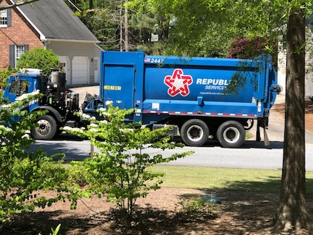 A Republic Services truck picks up residential garbage on a Coventry subdivision street earlier this year. Photo/Cal Beverly.