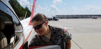 Cadet Chief Master Sergeant Dawn Patrick gathers her belongings after completing an airborne photographic mission in the aftermath of Hurricane Dorian. Photo/Civil Air Patrol mission pilot Lt. Col. Larry Taylor.