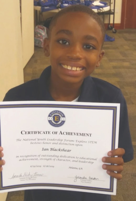 Ian Blackshear holds his certificate of achievement from the National Youth Leadership Forum.