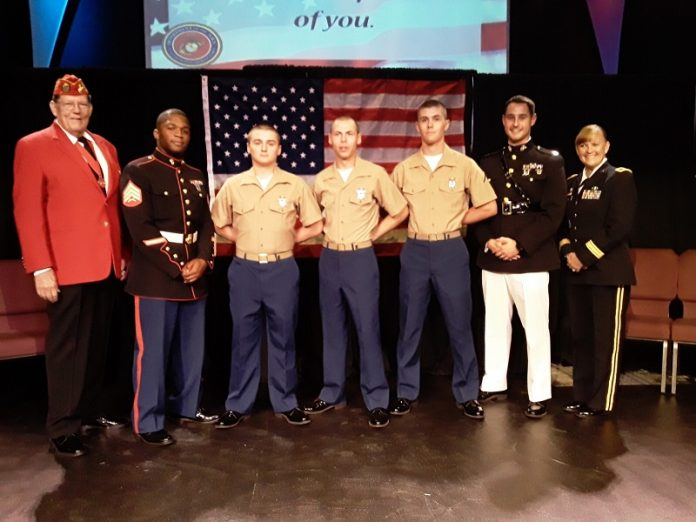 Participating in a local U.S. Marine Corps boot camp graduation after ceremonies on Paris Island were cancelled due to Hurricane Dorian were, from left, Guy Mitchell (USMC), Sergeant Quayshaun Spence (USMC), Pvt. Clay Fordham, Pvt. Aaron Hornbuckle, PFC David Wilkins, PFC Riley Walsh (not pictured), Captain Sabia (USMC) and Brigadier General Nikki Griffin-Olive (US Army). Photo/Submitted.