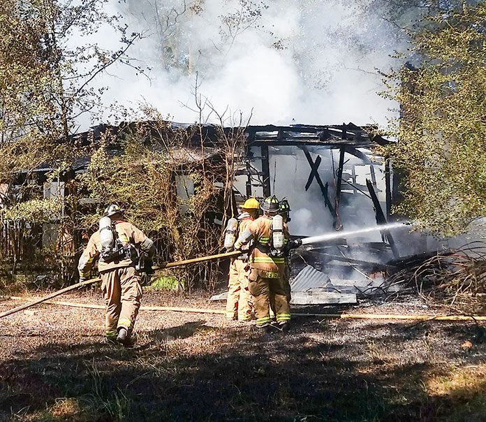 Firefighters on Sept. 4 battled a fire at an unoccupied home on Ga. Highway 85 South. Photo/Fayette County Fire and Emergency Services.