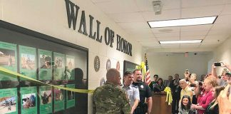 The McIntosh High School Wall of Honor honoring former students, faculty and staff who served in the military was unveiled on Sept. 6 before a wealth of visitors. Photo/Ben Nelms.