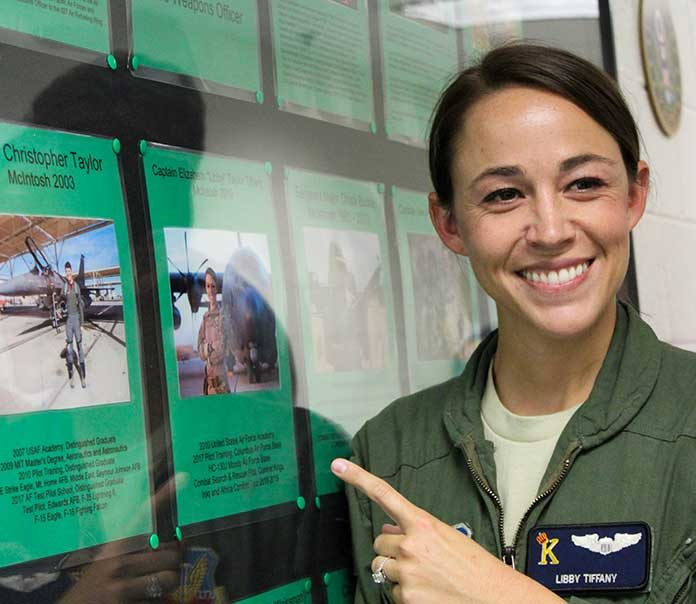 """Capt. Elizabeth """"Libby"""" Tiffany points out her photo on the Wall of Honor at her alma mater, McIntosh High School. Photo/Samantha Cornett."""