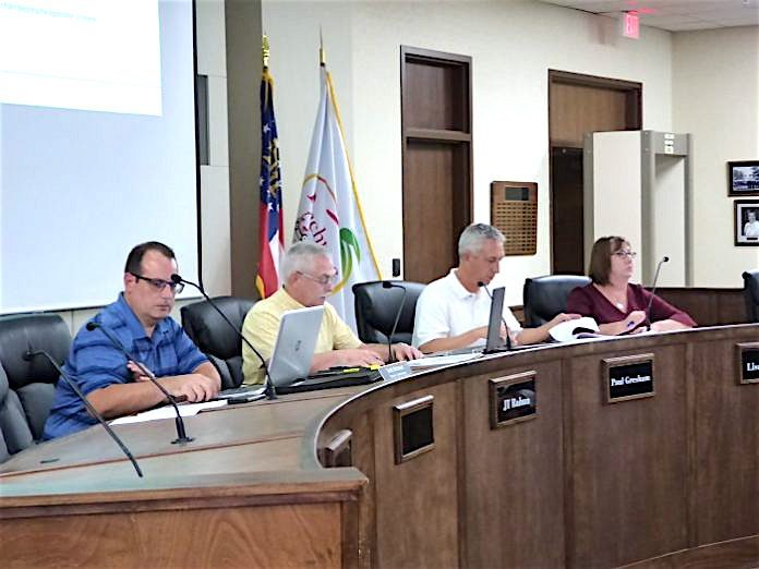 Peachtree City Planning Commission members at the Sept. 9 meeting included, from left, non-voting alternate Commissioner Scott Ritenour, Vice Chairman J.T. Rabun and commissioners Paul Gresham and Lisa Ann Curtis. Photo/Ben Nelms.