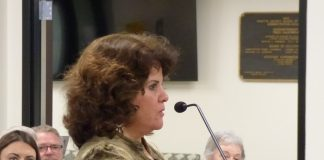 Peachtree City Mayor Vanessa Fleisch at the Sept. 25 public hearing on Booth Middle School. Photo/Ben Nelms.
