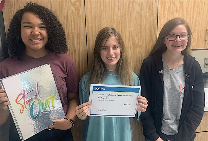 2020 Legend editors Jaylen Smith (12), with a copy of the 2019 book; Rachel Edge (12), holding the NSPA award; and Natalie Spellman (10). Photo by Landon Wilde.