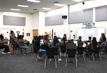 Fayette County High School Orchestra students perform for composer. Photo/Fayette County School System.