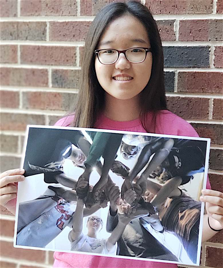 <b>Below, MHS Student Media GSPA Photo Contest winners, holding their winning entries. Photos by Shanon Woolf.</b>