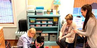 Becky Hall, certified therapy dog trainer, reads to the Lower School class with therapy dog Libby, while teacher Caroline Breslin (from left) and teacher assistant Martha Butler look on. Photo/Submitted.