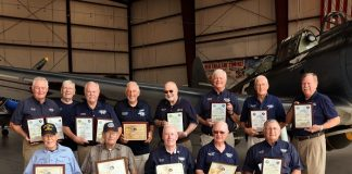 "Three CAF Dixie Wing members honored this month for more than 50 years each of service as pilots and mechanics were joined by 10 previous winners from the Dixie Wing. The entire group gathered at the Dixie Wing Warbird Museum to show the depth of experience within the Dixie Wing membership. From left, back row are: Tony Stein, John Flynn, Jim Buckley, Charles Kennedy, Elmer Koldoff, Ric Carlson, Willard Womack and Andy Anderson. Front row, from left, are: Willie Dickerson, Bill Baldwin, Ron Gause, George Harrison and Ray ""Pop"" Wilson. Photo/Charles Burcher."