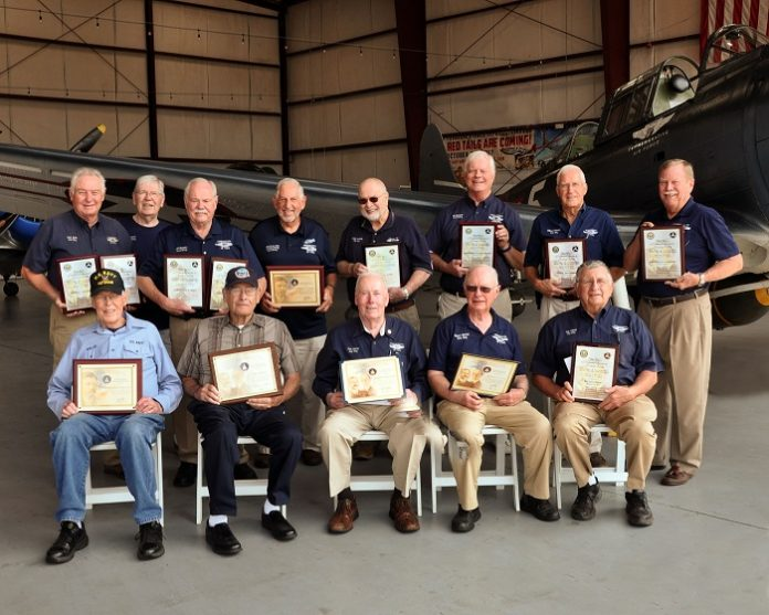 Three CAF Dixie Wing members honored this month for more than 50 years each of service as pilots and mechanics were joined by 10 previous winners from the Dixie Wing. The entire group gathered at the Dixie Wing Warbird Museum to show the depth of experience within the Dixie Wing membership. From left, back row are: Tony Stein, John Flynn, Jim Buckley, Charles Kennedy, Elmer Koldoff, Ric Carlson, Willard Womack and Andy Anderson. Front row, from left, are: Willie Dickerson, Bill Baldwin, Ron Gause, George Harrison and Ray