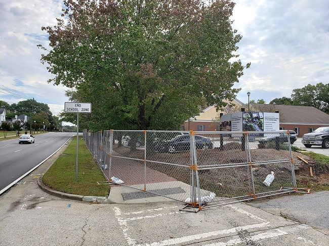 The fence in front of the old school system building on Ga. Highway 54 in Fayetteville is in place for the upcoming demolition of the building, set for the next few days. Photo/City of Fayetteville.