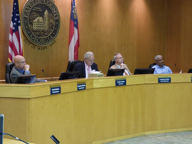 Fayette County commissioners hearing a rezoning request on Oct. 24 included, from left, Commissioner Edge Gibbons, Chairman Randy Ognio and commissioners Chuck Oddo and Charles Rousseau. Photo/Ben Nelms.