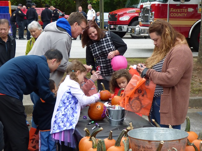 Pumpkin painting was just one of the many activities at the Public Safety Fall Festival, held Oct. 18 at the Fayette County Justice Center. Photo/Ben Nelms.