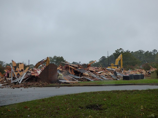 Demolition of the former Fayette County Board of Education building on Stonewall Avenue in Fayetteville began Oct. 30. The new City Hall and adjoining City Center Park to be located on the 10-acre site are expected to open in late 2020 or early 2021. Photo/Ben Nelms.