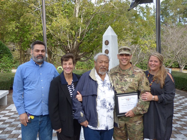 Captain Guy Serapion was joined by his family on Oct. 18 as he was recognized by local veterans organizations at the Veterans Memorial in Peachtree City. Pictured, from left, are brother Chad, mom Barbara, dad Ben, Guy and wife Nicole. Photo/Ben Nelms.