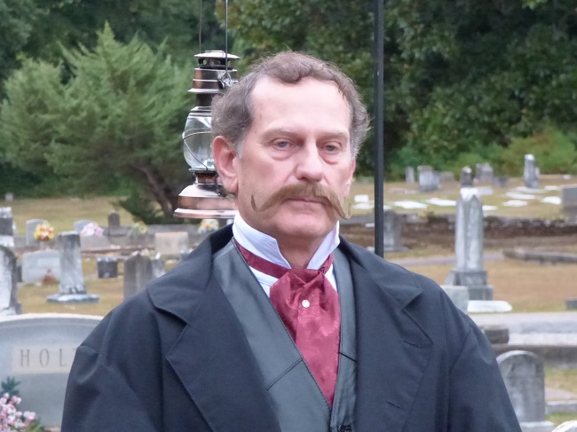 "Doug Utt, playing the ghost of ""Doc"" Holliday, gave tour groups a history lesson during the annual Spirit Walk held Oct. 18 at the Fayetteville Cemetery. Photo/Ben Nelms."